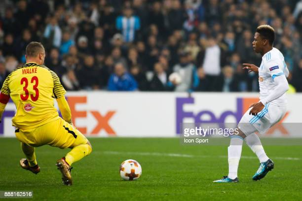 Clinton NJie of Marseille and Alexander Walke of Salzburg during the Uefa Europa League match between Olympique de Marseille and Red Bull Salzburg at...