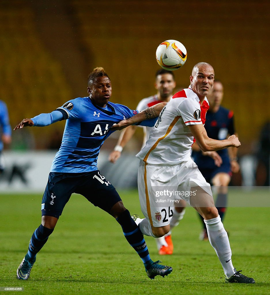Clinton N'Jie of Tottenham Hotspur and Andrea Raggi of Monaco battle for the ball during the UEFA Europa League group J match between AS Monaco FC and Tottenham Hotspur FC at Stade Louis II on October 1, 2015 in Monaco, Monaco.