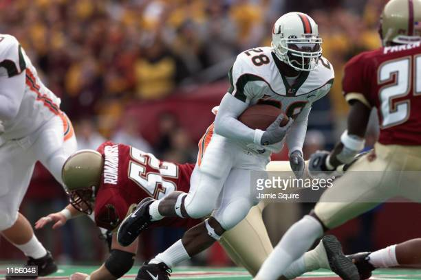Clinton Portis of the Miami Hurricanes runs with the ball as Andy Romanowsky misses the tackle during the game on November 10, 2001 at Alumni Field...