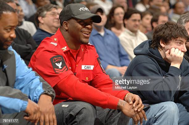 Clinton Portis of the Washington Redskins attends a Georgetown Hoyas basketball game against the South Florida Bulls at Verizon Center on February 5...