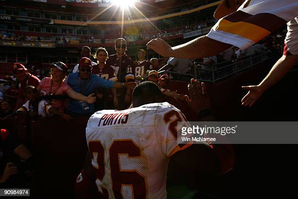 Clinton Portis of the Washington Redskins heads to the locker room after his team ran out the clock against the St Louis Rams during their game on...