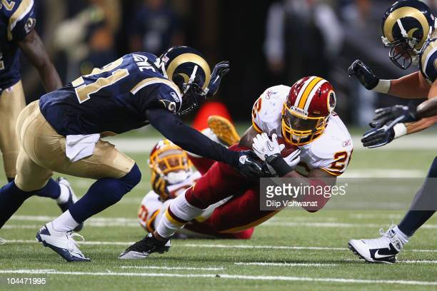 Clinton Portis of the Washington Redskins is tackled against the St Louis Rams at the Edward Jones Dome on September 26 2010 in St Louis Missouri The...