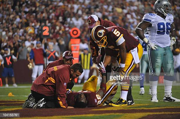 Clinton Portis of the Washington Redskins lies injured on the turf during the NFL season opener against the Dallas Cowboys at FedExField on September...