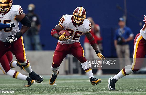 Clinton Portis of the Washington Redskins runs the ball against the New York Giants on September 13 2009 at Giants Stadium in East Rutherford New...
