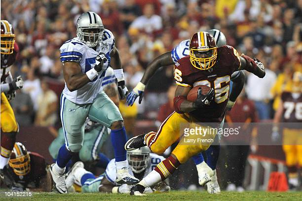 Clinton Portis of the Washington Redskins runs the ball during the NFL season opener against the Dallas Cowboys at FedExField on September 12 2010 in...
