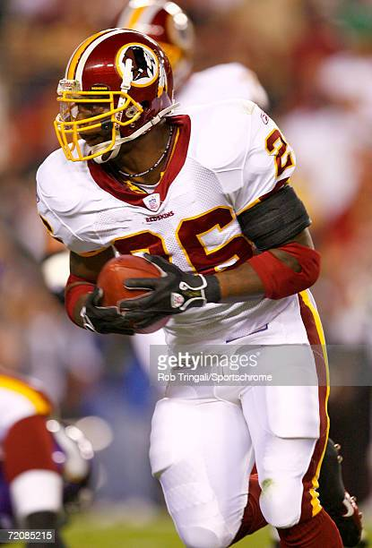 Clinton Portis of the Washington Redskins runs with the ball against the Minnesota Vikings on September 11, 2006 at FedExField in Landover, Maryland....