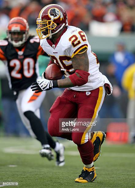 Clinton Portis of the Washington Redskins runs with the ball during the NFL game against the Cincinnati Bengals at Paul Brown Stadium December 14...