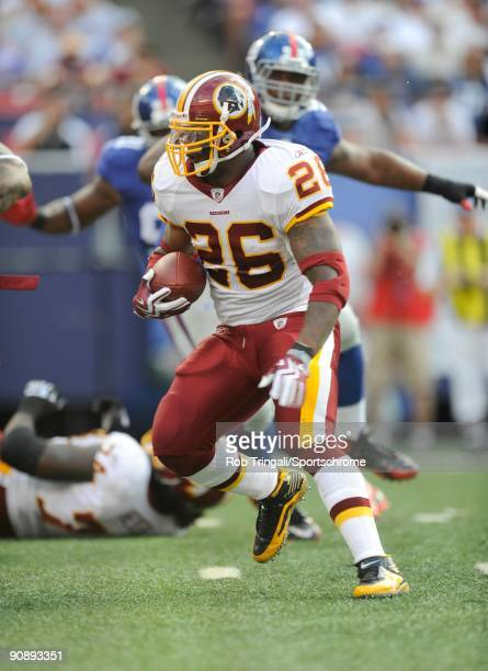 Clinton Portis of the Washington Redskins rushes against the New York Giants during their game on September 13 2009 at Giants Stadium in East...