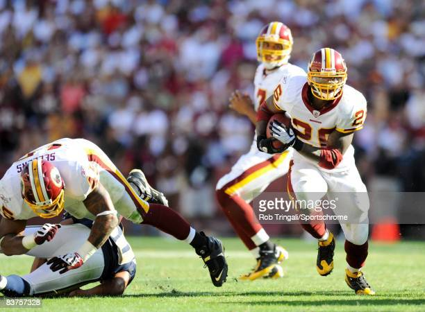 Clinton Portis of the Washington Redskins rushes against the St. Louis Rams at FedEx Field on October 12, 2008 in Landover, Maryland. The Rams...
