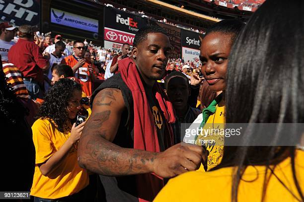 Clinton Portis of the Washington Redskins signs autographs before the game against the Denver Broncos at FedExField on November 15 2009 in Landover...