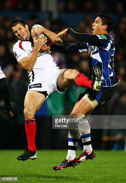 Clinton Schifcofske of Ulster catches the ball under pressure from Shontayne Hape of Bath during the Heineken Cup pool Four match between Ulster and...