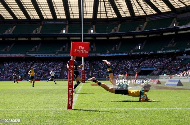 Clinton Stills of Australia scores a try during the Pool D match between Australia and Scotland during day one of the IRB London Sevens at Twickenham...