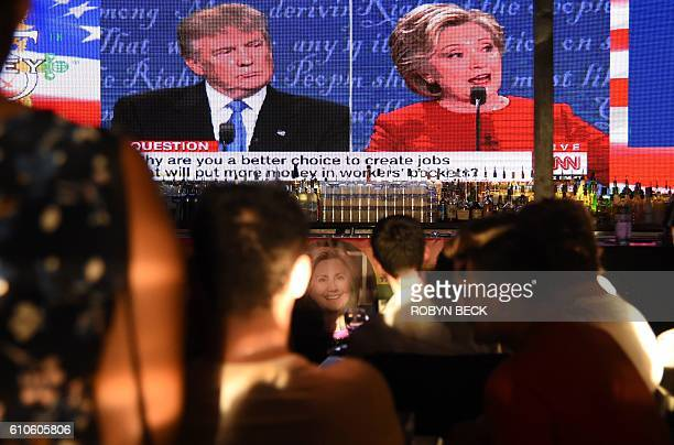 Clinton supporters watch the first US presidential debate between Democratic candidate Hillary Clinton and Republican Donald Trump at a debate watch...