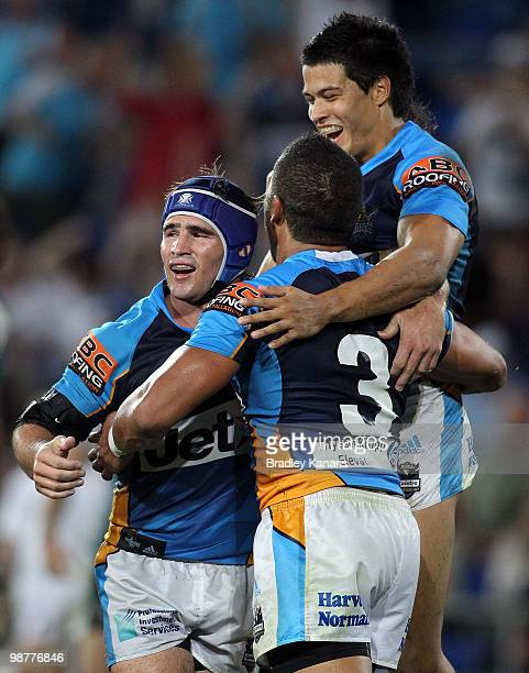 Clinton Toopi of the Titans celebrates with team mates after scoring a try during the round eight NRL match between the Gold Coast Titans and the...