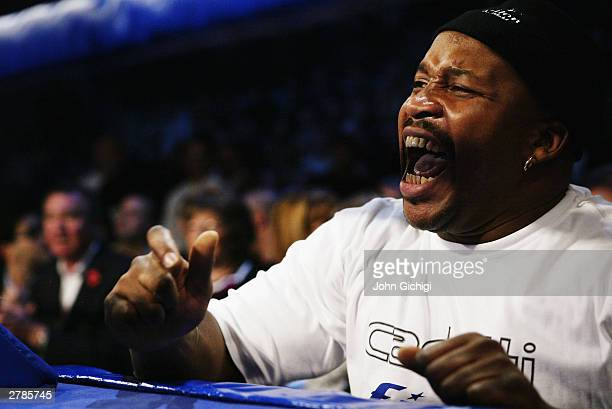 Clinton Woods' trainer Tim Witherspoon shouts encouragement during the IBF Light Heavyweight title fight against Glencoffe Johnson held at the...