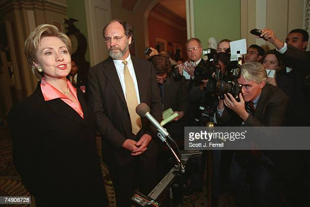 CLINTONSenatorselect Hillary Rodham Clinton DNY and Jon Corzine DNJ speak with the media in the Ohio Clock Corridor after an orientation presentation...