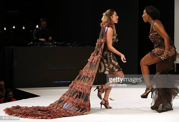 Clio Pajczer and Nadege BeaussonDiagne walk the runway during the Chocolate Fashion Show as part of Salon du Chocolat Paris 2016 at Parc des...