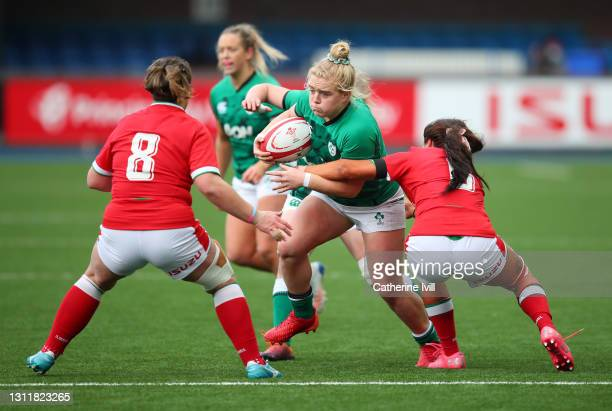 Cliodhna Moloney of Ireland is challenged by Georgia Evans and Siwan Lillicrap of Wales during the Women's Six Nations match between Wales and...