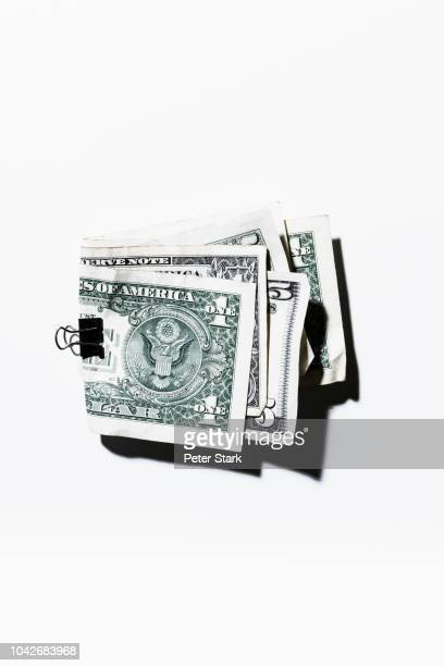 clip holding folded one and five dollar bills - american one dollar bill stock pictures, royalty-free photos & images
