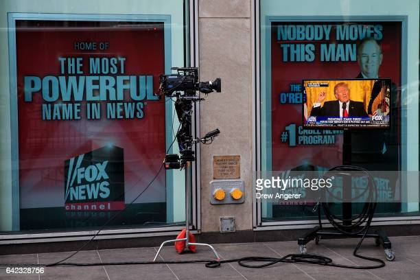 A clip of President Donald Trump's Thursday press conference is played on 'Fox And Friends' seen on a monitor outside of the Fox News studios on...