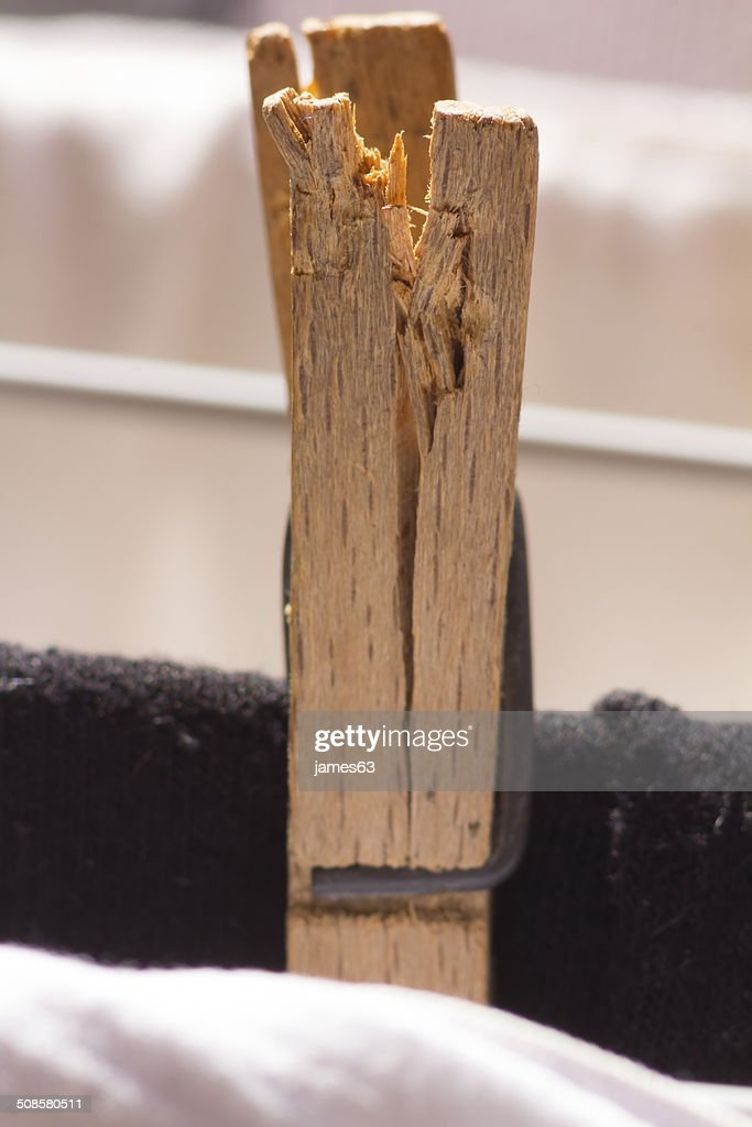 clip old broken wooden clothesline : Stock Photo