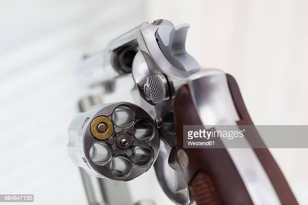 Clip with one cartridges, revolver, close-up