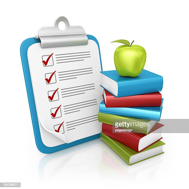 clipboard and apple on books