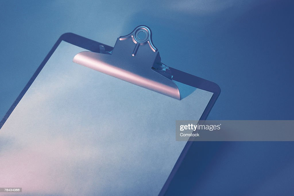 Clipboard and paper : Stockfoto