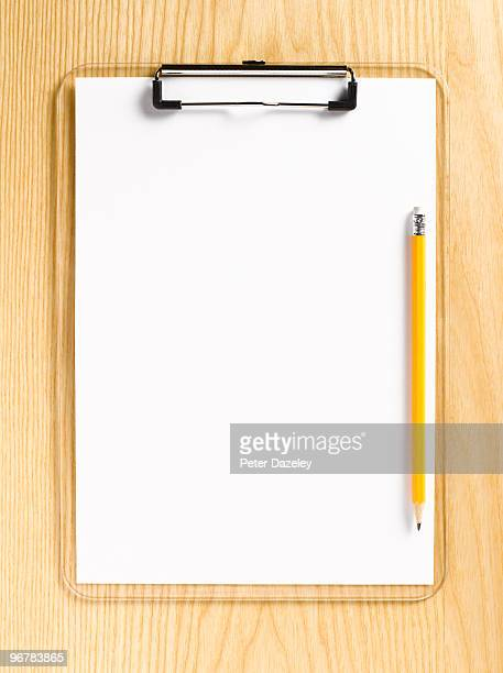Clipboard with clean paper and pencil