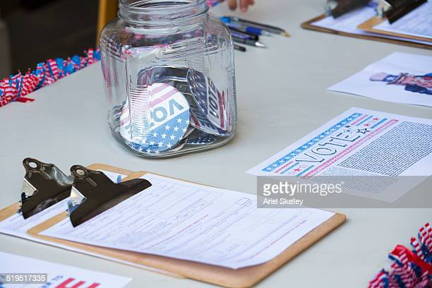 clipboards and buttons at voter registration table - election stock pictures, royalty-free photos & images