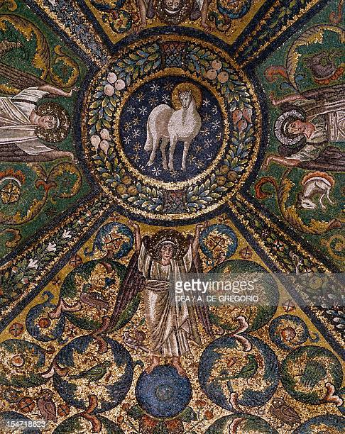Clipeus with the Mystic Lamb being supported by four angels and nature symbols mosaic groin vault of the presbytery Basilica of San Vitale Ravenna...