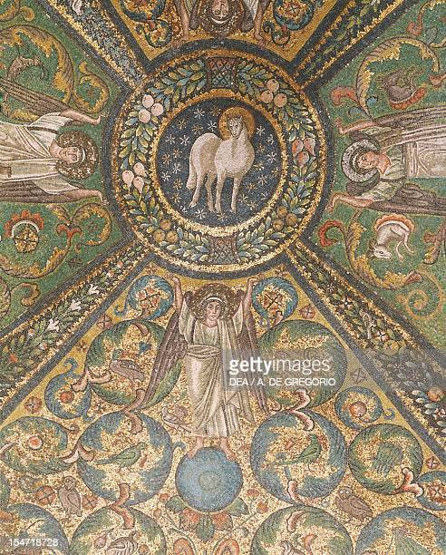 Clipeus with the Mystic Lamb being supported by four angels and nature motifs mosaic groin vault of the presbytery Basilica of San Vitale Ravenna...