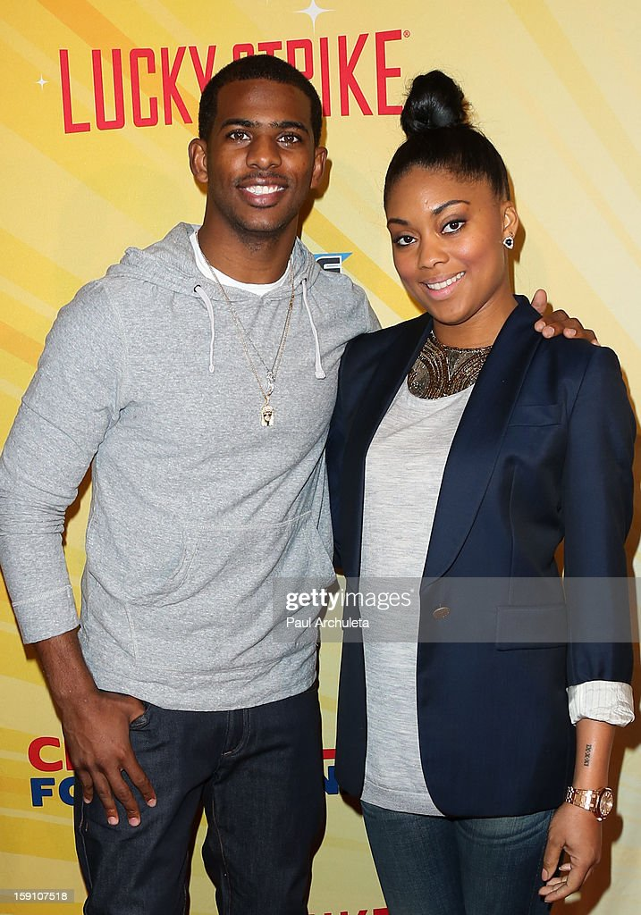 LA Clipper Chris Paul (L) and Jada Crawley (R) attend the 5th annual Chris Paul PBA All-Stars charity tournament at Lucky Strike Lanes at L.A. Live on January 7, 2013 in Los Angeles, California.
