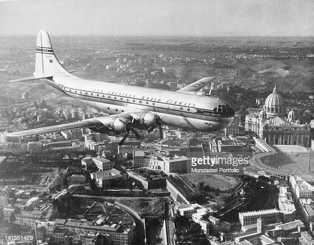 'Clipper' passenger aircraft of 'Pan American World Airways' flying over the town Rome 1950s