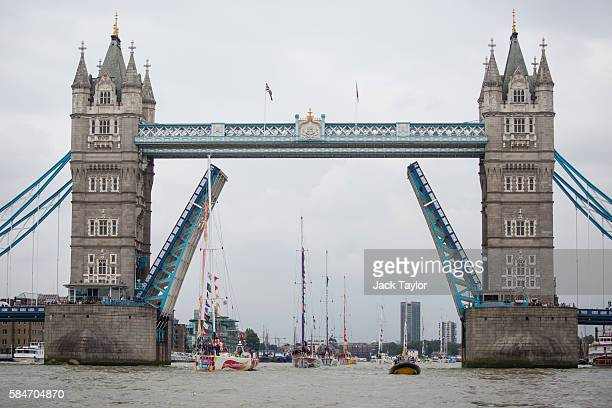 Clipper racing yachts pass under Tower Bridge along the River Thames before finishing at St Katharine Docks on July 30 2016 in London England The...