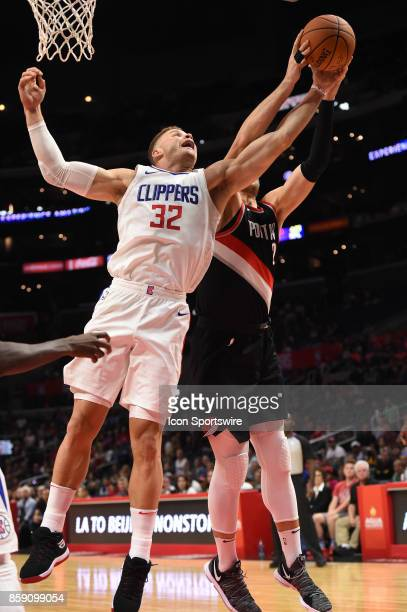 Clippers Blake Griffin and Trail Blazers Archie Goodwin reach for a rebound during an NBA preseason game between the Portland Trail Blazers and the...