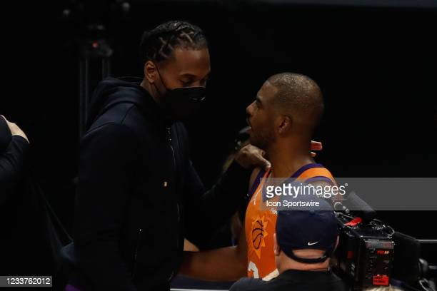 Clippers forward Kawhi Leonard talks with Phoenix Suns guard Chris Paul during game 6 of the NBA Western Conference Final between the Phoenix Suns...