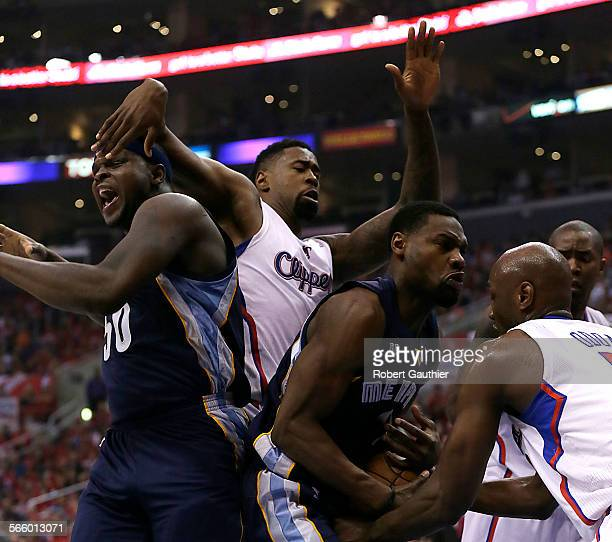 Clippers forward Lamar Odom ties up Grizzlies guard Tony Allen for a jump ball as DeAndre Jordan and Zach Randolph battle for position during first...