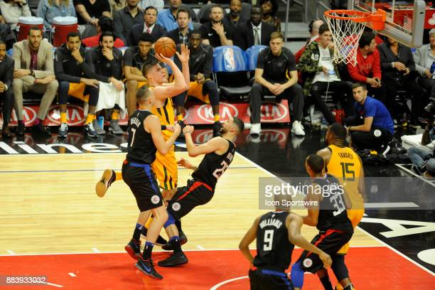 Clippers G Austin Rivers and Sam Dekker apply defensive coverage to Utah's Jonas Jerebko during the second half of their game against the Utah Jazz...