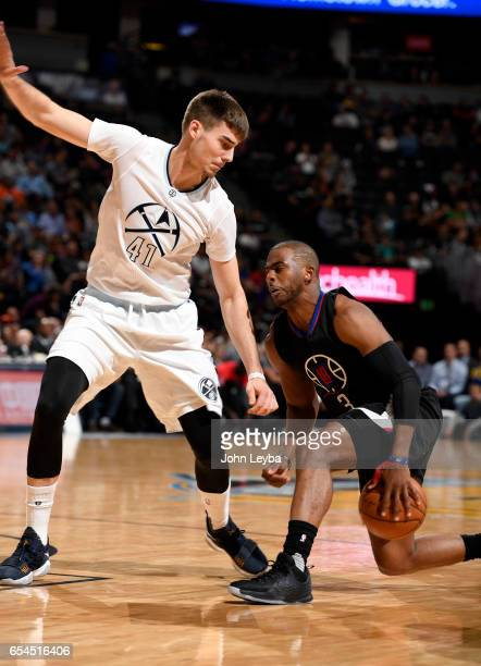 Clippers guard Chris Paul puts a move on Denver Nuggets forward Juancho Hernangomez during the third quarter on March 16 2017 in Denver Colorado at...