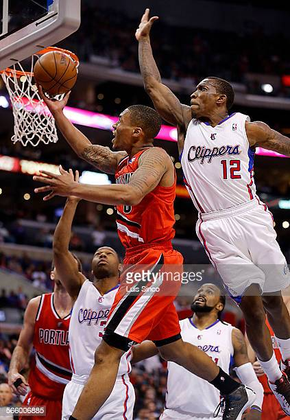 Clippers guard Eric Bledsoe prepres to block a shot by Blazers guard Damian Lillard but was called for a foul in the fourth quarter Tuesday, April 16...