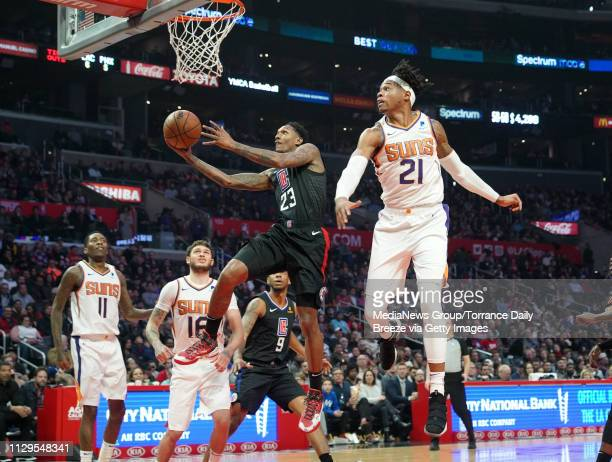 Clippers guard Lou Williams scores ahead of the block by Phoenix Suns forward Richaun Holmes at the Staples Center in Los Angeles on Wednesday Feb 13...