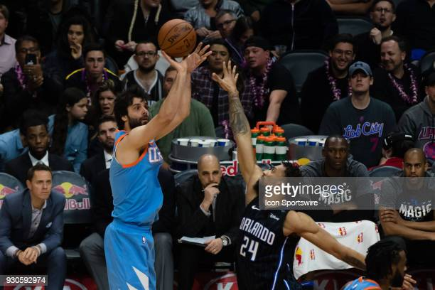 Clippers guard Milos Teodosic shoots a basket over the top of Orlando Magic center Khem Birch during the game between the Orlando Magic and the LA...