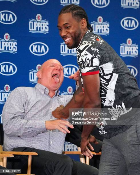 Clippers owner Steve Ballmer laughs after hugging new player Paul George during a press conference at the Green Meadows Recreation Center in Los...