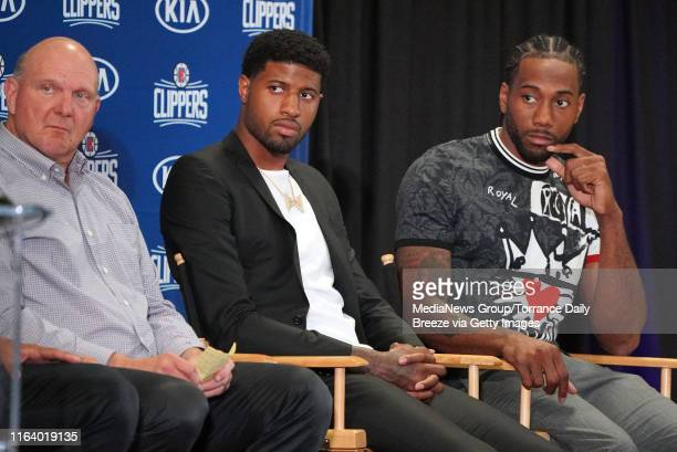 Clippers owner Steve Ballmer left joins new players Paul George center and Kawhi Leonard at a press conference at the Green Meadows Recreation Center...