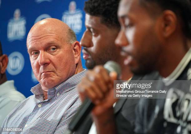 Clippers owner Steve Ballmer left looks on at his new players Paul George and Kawhi Leonard right during a press conference at the Green Meadows...