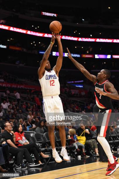Clippers Tyrone Wallace shoots over Trail Blazers Archie Goodwin during an NBA preseason game between the Portland Trail Blazers and the Los Angeles...