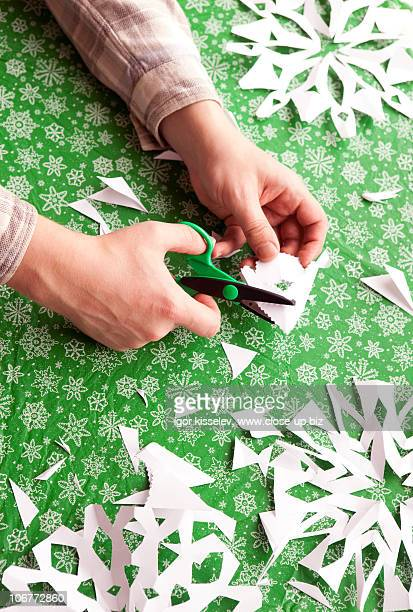 Clipping paper snowflakes