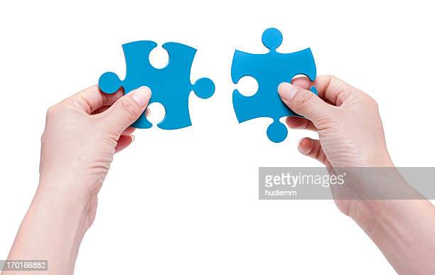 [Clipping path!] Woman Putting together jigsaw puzzle pieces isolated