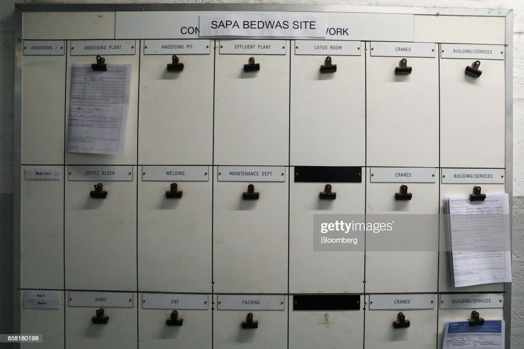Clips hang from a notice board at the Sapa SA aluminum plant in Bedwas, U.K., on Wednesday, Oct. 4, 2017. After being closed for three years due to a weak market, Sapa's aluminum plant in south Wales reopened to supply lightweight parts for automakers such as London Electric Vehicle Co., the maker of black cabs. Photographer: Luke MacGregor/Bloomberg via Getty Images